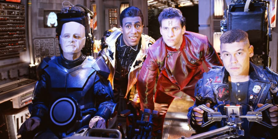 The Red Dwarf crew looking heroic in Starbug's cockpit