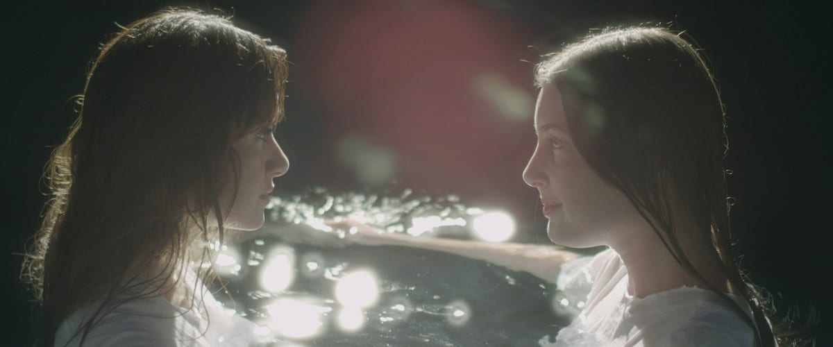 Savannah and Janie in water together speaking in unison