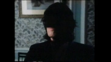 Roger Waters with his face half in shadow in the video for The Final Cut