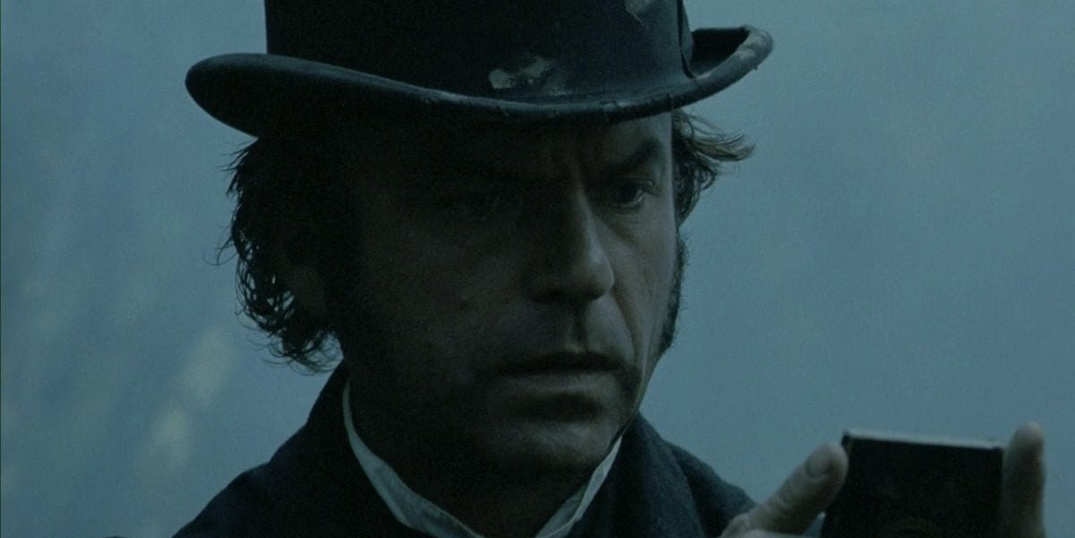 Sam Neill wearing a top hat