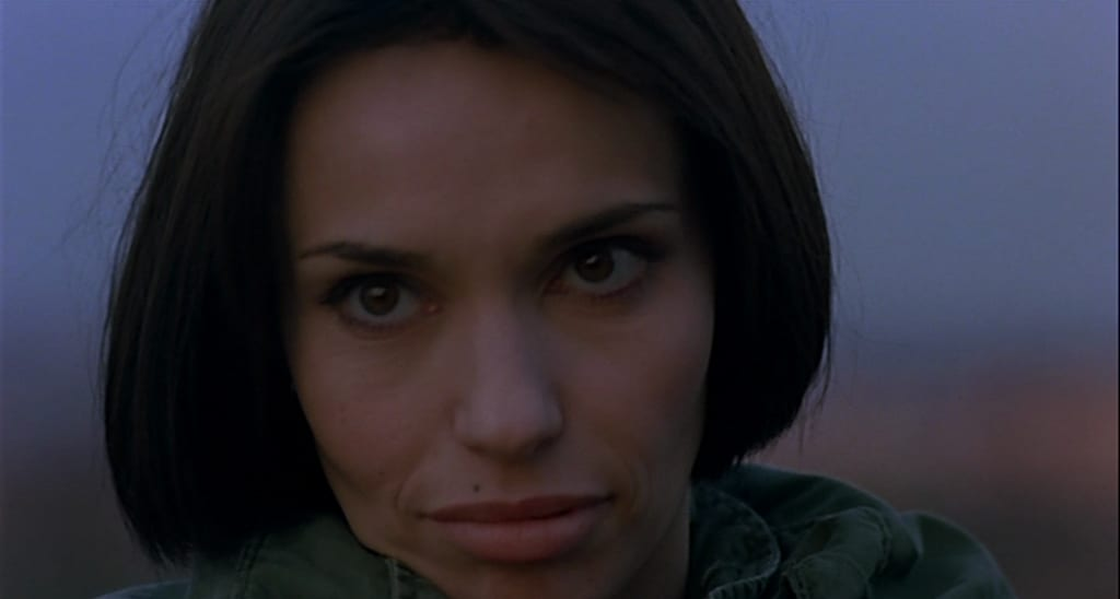 Core with a gaze of sexual desire and hunger, played by Beatrice Dalle