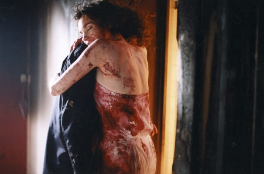 Shane and Core hug with smiles, she is drenched in blood