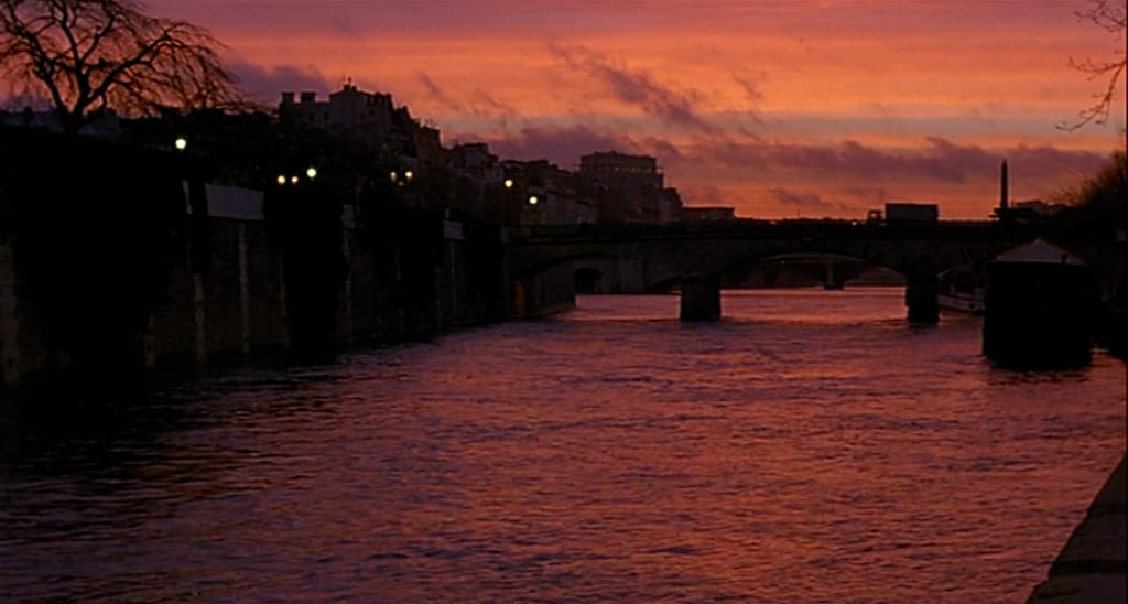 The Seine at dawn, bathed in purple and orange sunlight
