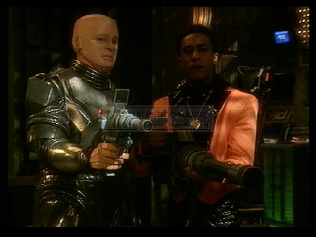 Kryten and The Cat point their bazookoids with intent