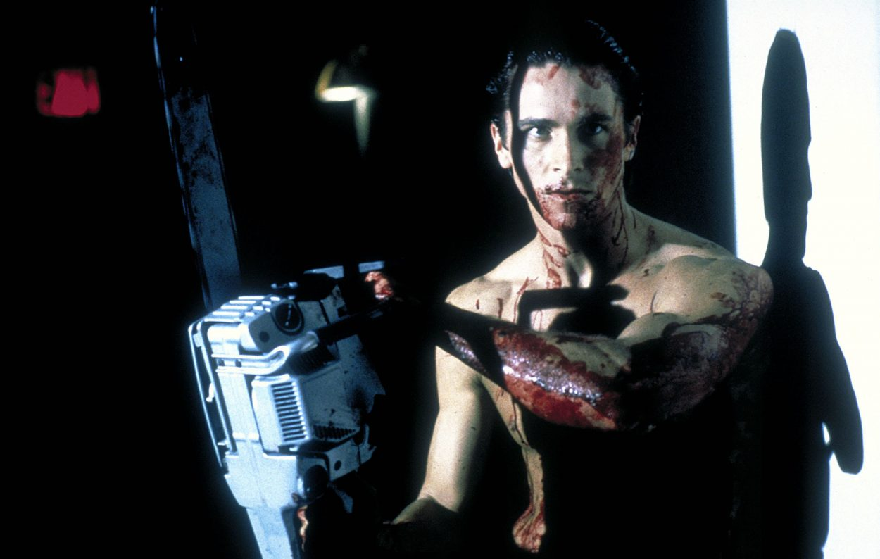 Bateman covered in blood, holding a chainsaw.