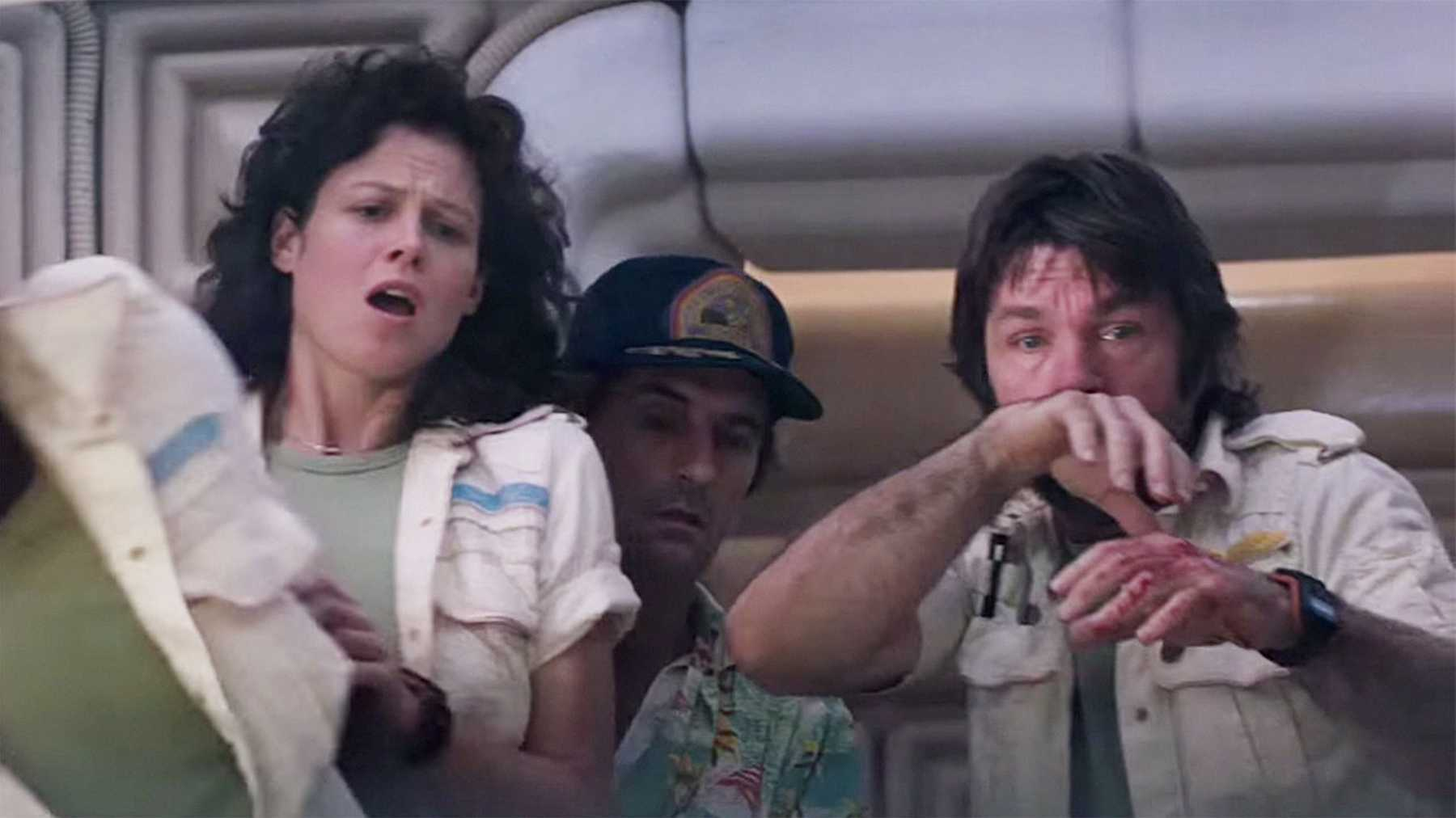Sigourney Weaver, Tom Skerritt and Harry Dean Stanton witness the birth of the Alien.