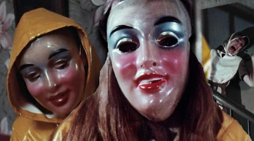 Two kids wearing yellow rain slickers and translucent masks, stand in front of a screaming woman.