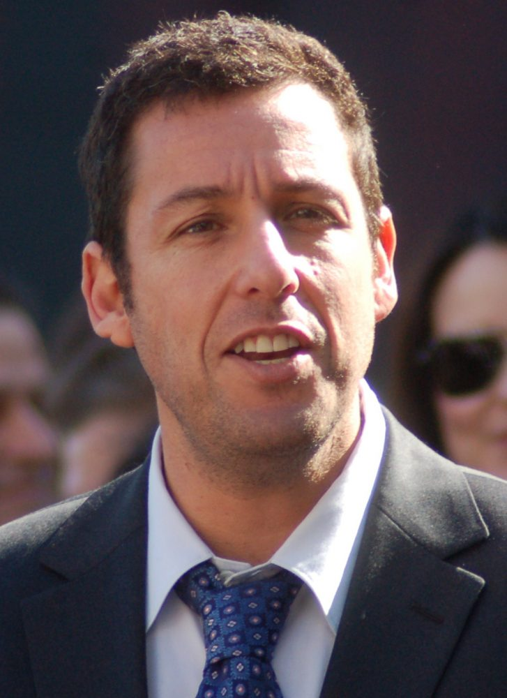 Adam Sandler in 2011 wearing a suit