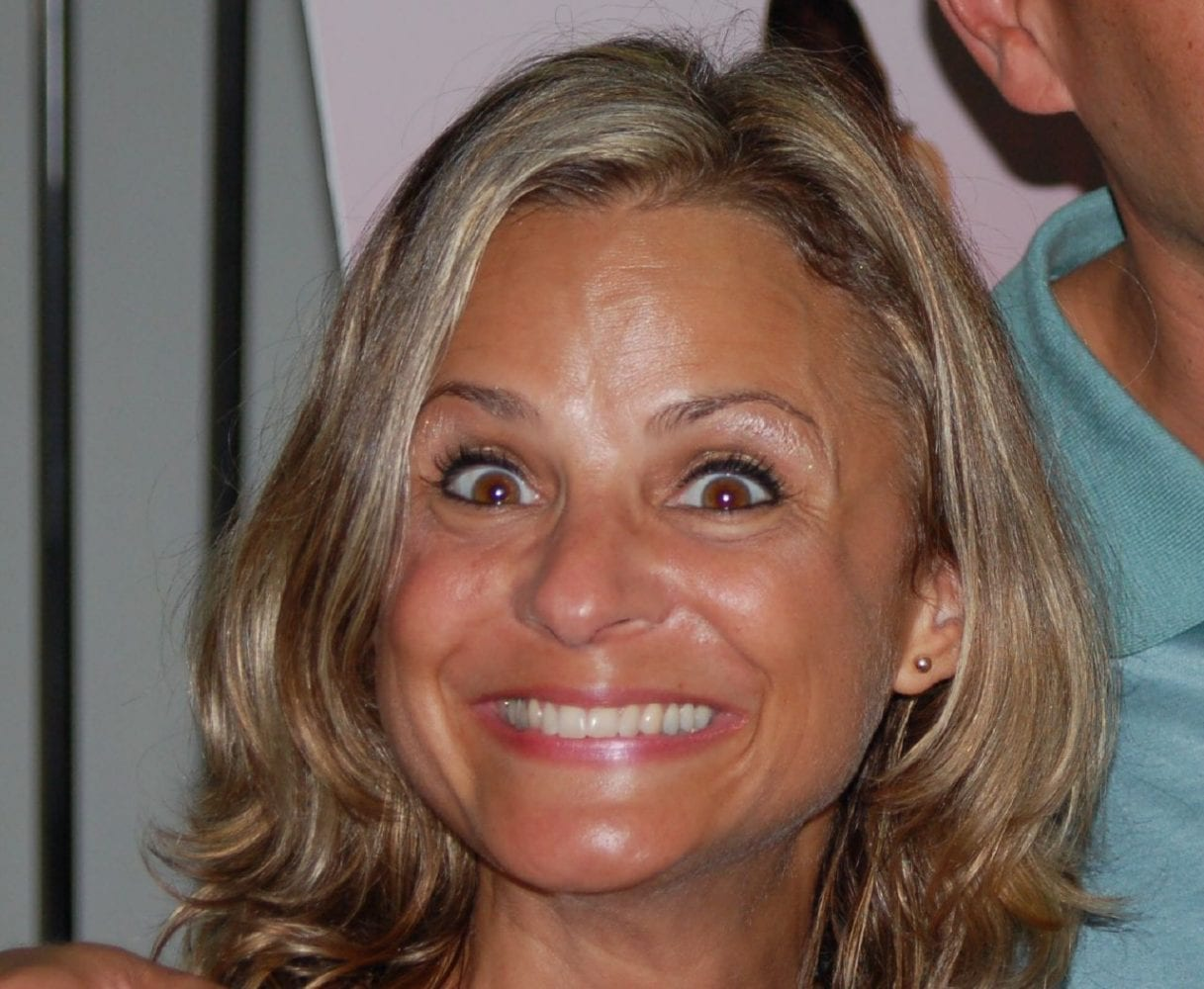 Amy Sedaris grinning maniacally