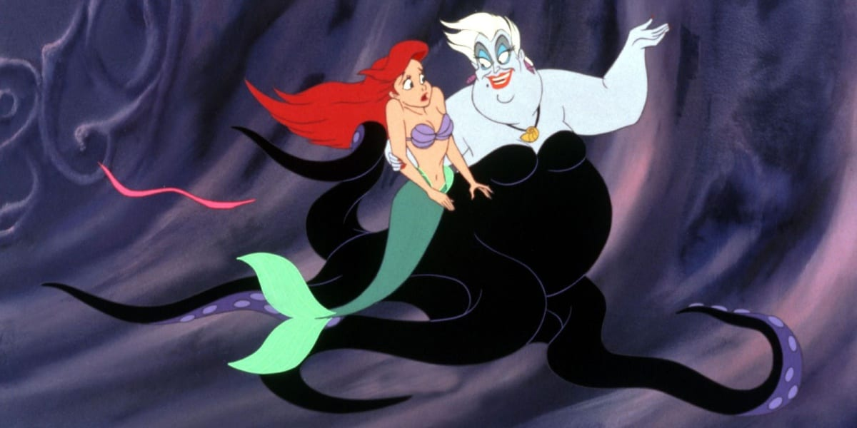 Ursula forcefully leads Ariel into her cave, with Ariel looking concerned in The Little Mermaid