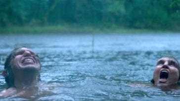 Eva Melander as Tina swims in the forest lake with Vore, played by Eero Milonoff