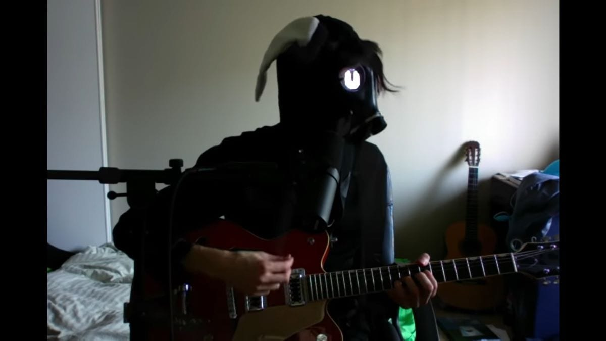 "Will Toledo in his new stage persona wearing a gas mask in the video for ""There must be more than blood"""