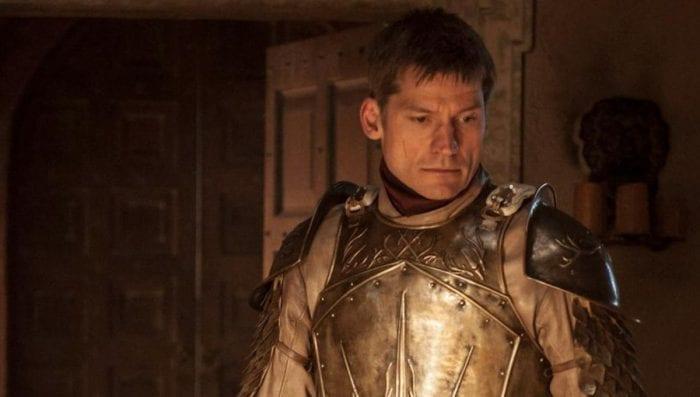 Jamie Lannister looks down wearing his armor but no helmet