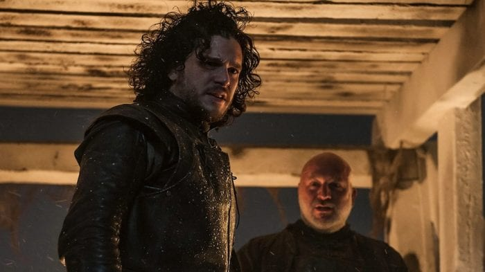 Jon Snow and Janos Slynt stand at the top of the Wall