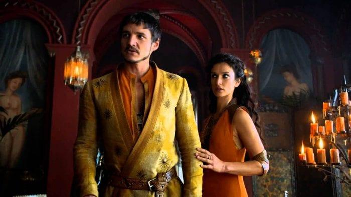 Oberyn Martell and Ellaria Sand walk through a brothel