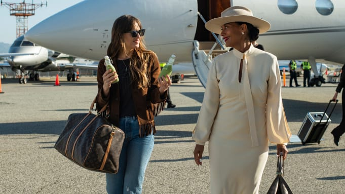 Maggie offers Grace a drink after deboarding her private jet.