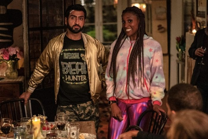 Jibran and Leilani awkwardly arrive at a dinner party in out-of-place clothing.
