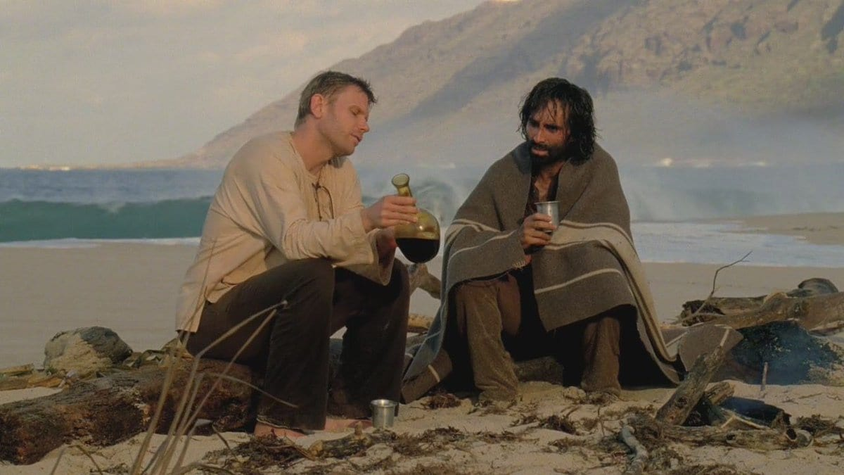 Jacob and Richard share wine on the beach