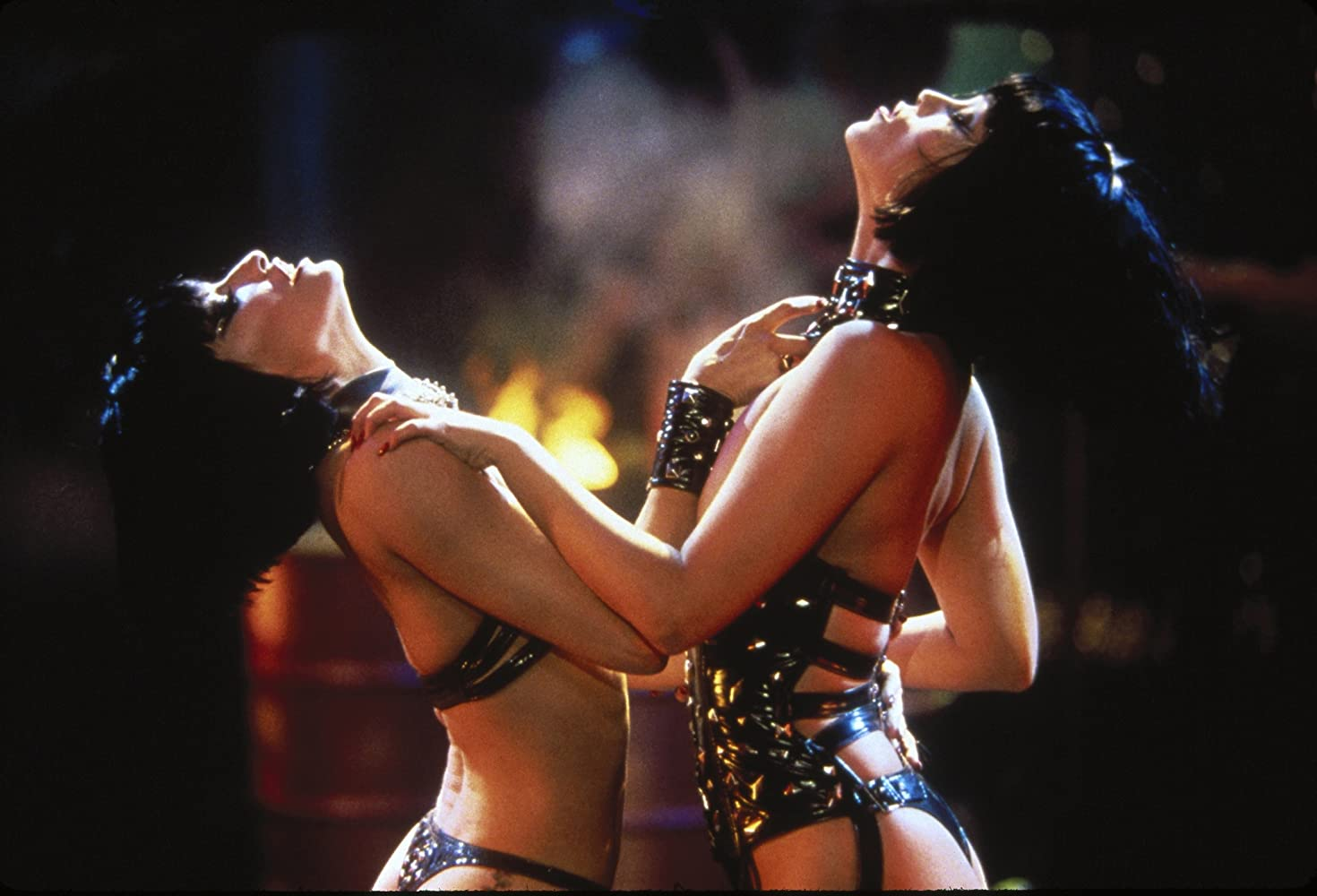 Nomi and Cristal dance in leather.