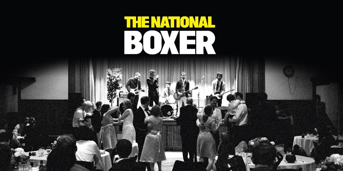 Cover image of The National's Boxer, depicting the band playing a concert at a wedding in black and white