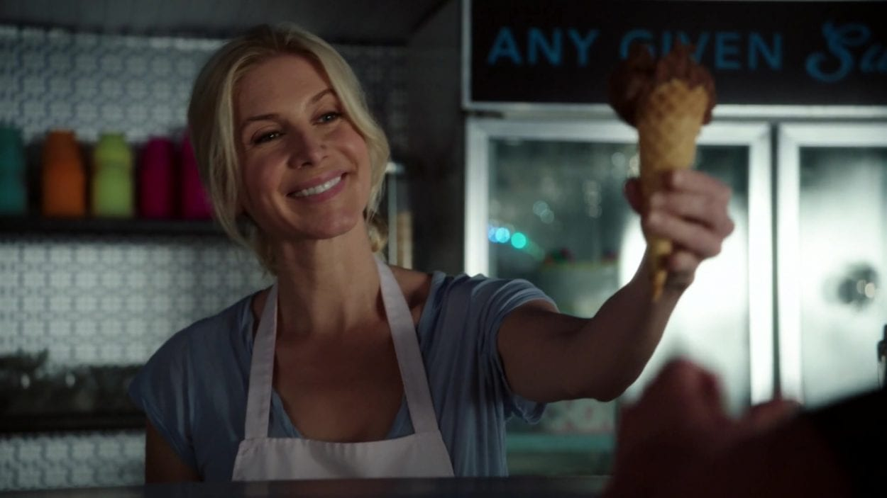 Ingrid (Elizabeth Mitchell) hands off an Ice cream in a scene from Once Upon A Time.