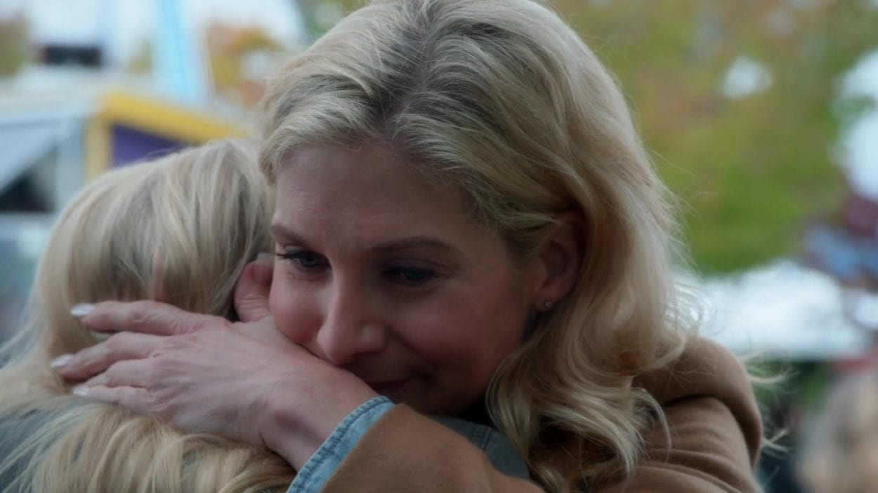 Ingrid (Elizabeth Mitchell) and young Emma (Abby Ross) share a hug in a scene from Once Upon A Time.