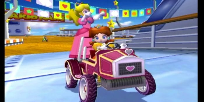 Peach and Daisy in a purple car with a heart on the grill in Mario Kart Double Dash