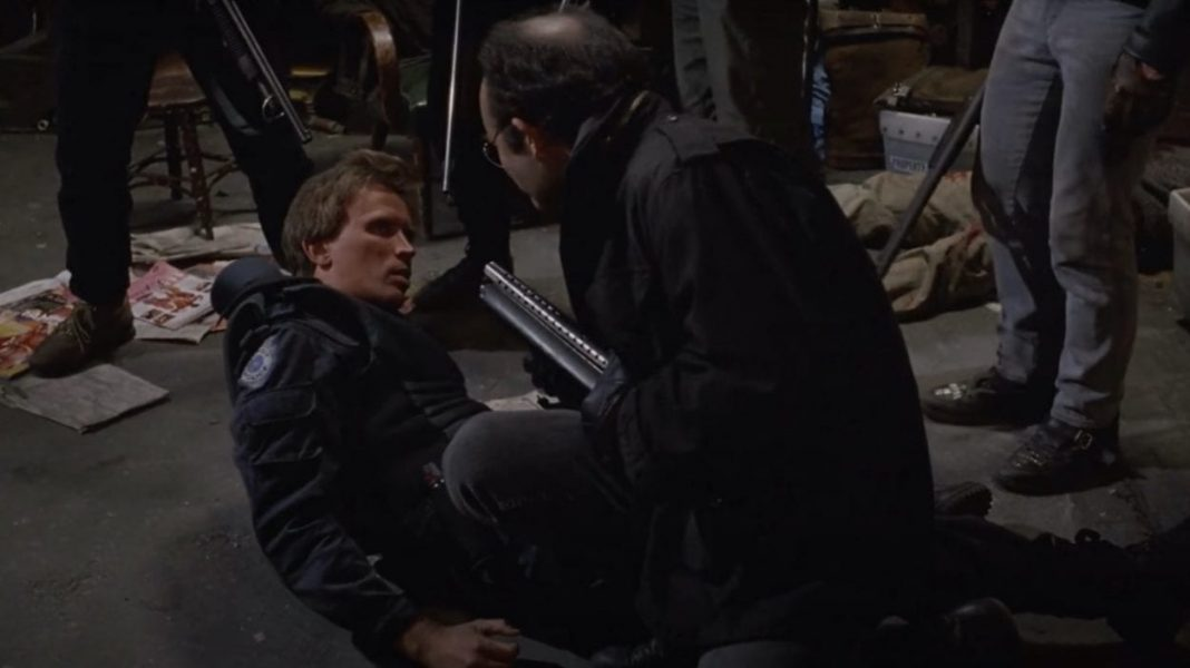 Kurtwood Smith levels the gun on Peter Weller.