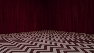 The red curtains and black and white chevron floor of the Black Lodge