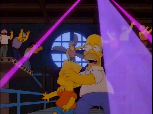 Homer covers Bart's eyes in a steel mill that's turned into a gay club