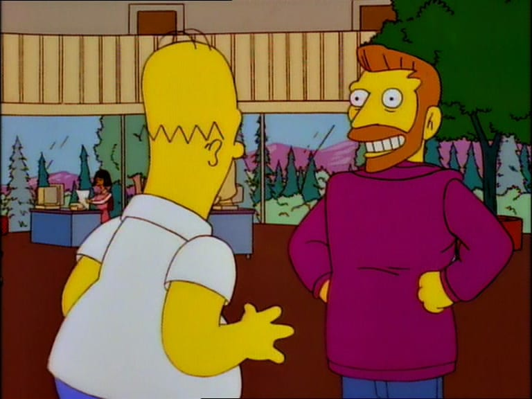 Hank Scorpio stands with his coat on backwards, grinning at Homer