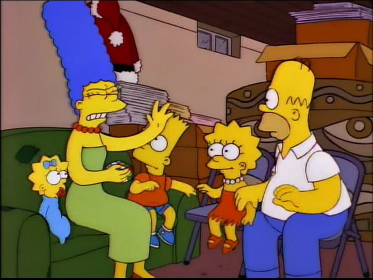 Marge looks annoyed holding a Rubik's cube as Maggie, Bart, Lisa and Homer look on