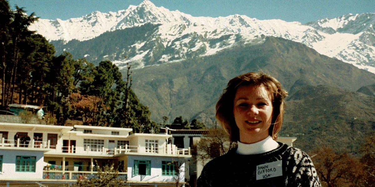 Dawn Gifford Engle in front of a mountain landscape