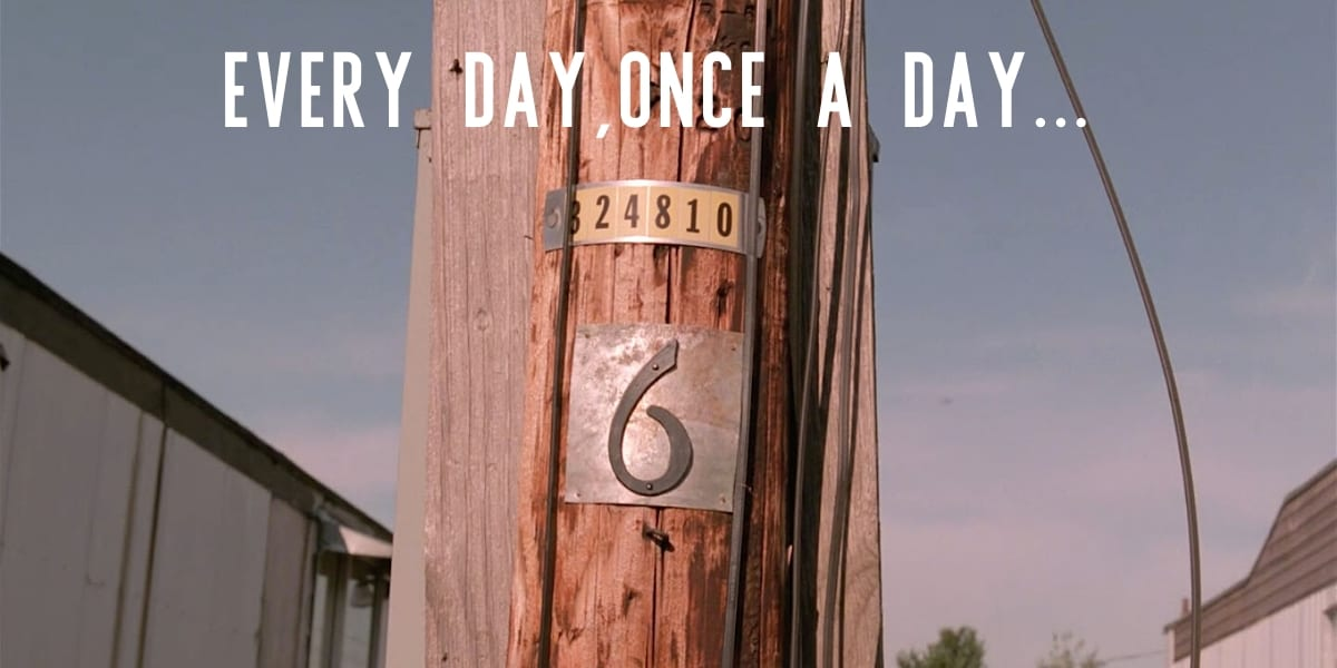 a telephone pole with the number 6