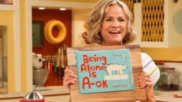 "Amy Sedaris holds a sign that says ""Being Alone is A-OK"" in At Home with Amy Sedaris"