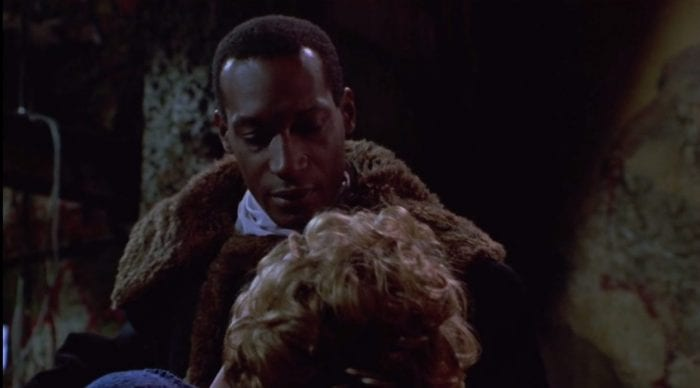 Front view of Candyman as he looks at Helen, who we see from behind.