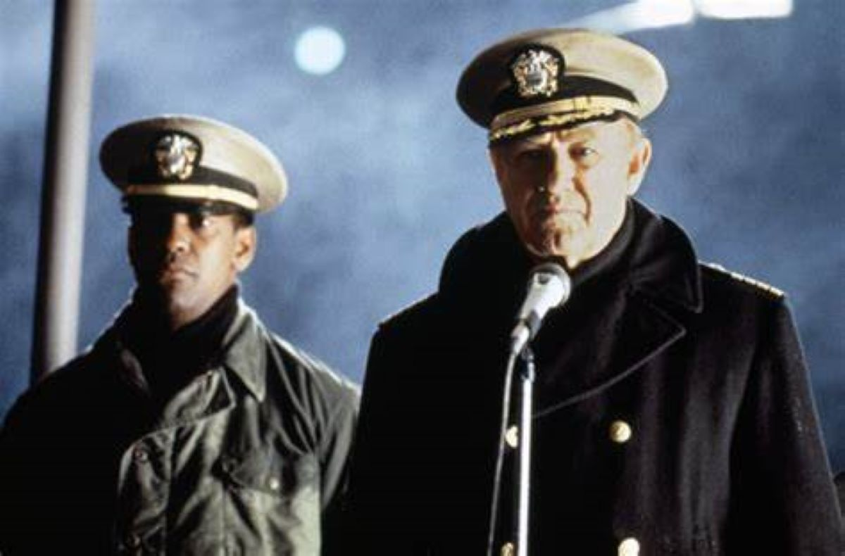 Denzel Washington and Gene Hackman speak at a microphone before going on a mission in Crimson Tide