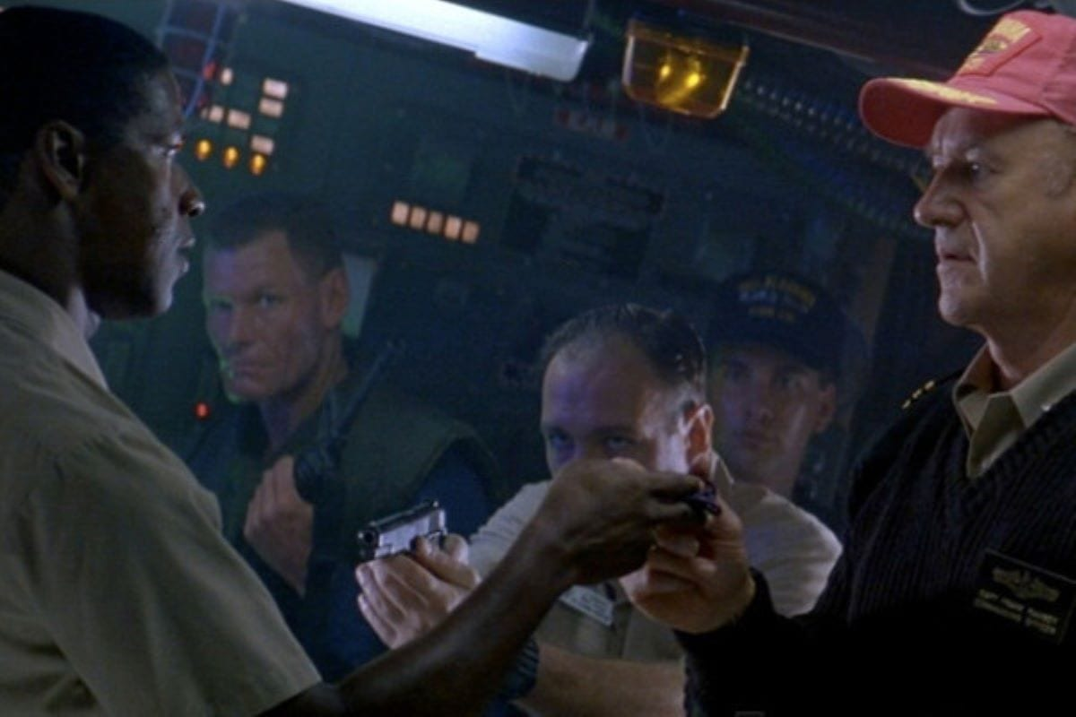 A tense standoff between Hunter and Ramsay on the USS Alabama, while Bobby Daugherty (James Gandolfini) points a gun at Hunter