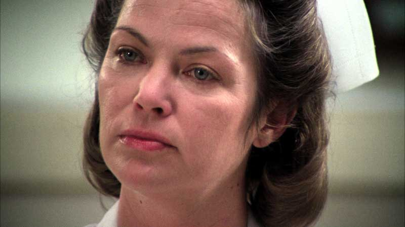 Nurse Ratched with a stern look on her face
