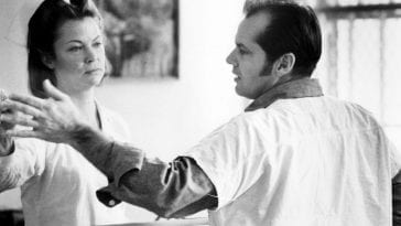 Nurse Ratched and McMurphy fight to close/open the office screen window