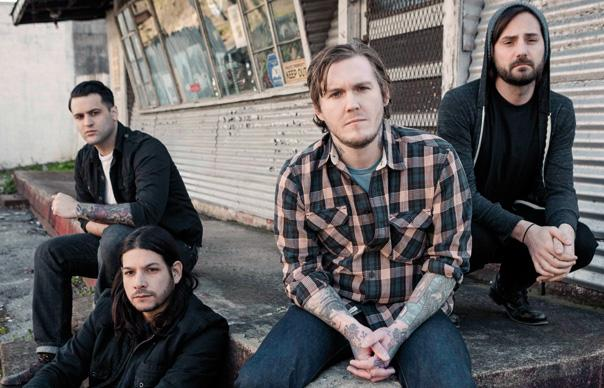Gaslight Anthem sit on a concrete step