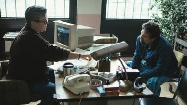 Dominick and Lisa Sheffer talk over a desk I Know This Much is True S1E2