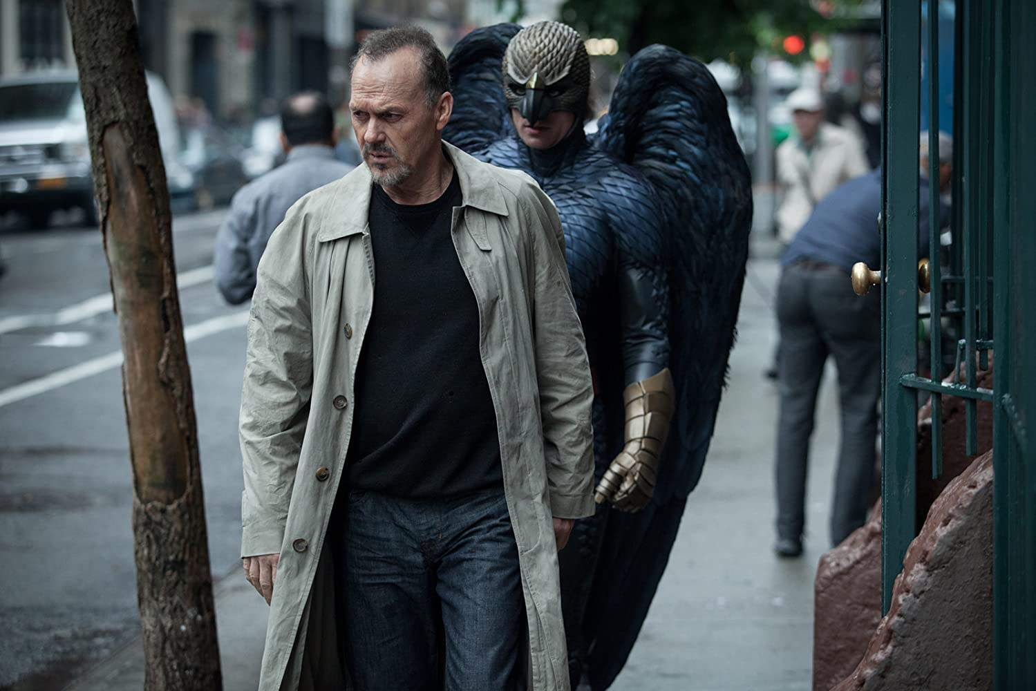 The former Birdman character appears to follow Riggan in his mind on a busy street.