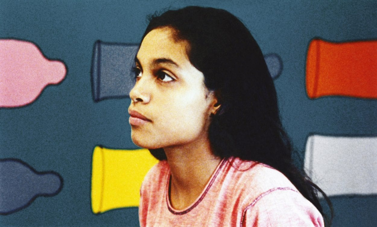 Ruby played by Rosario Dawson at a testing clinic