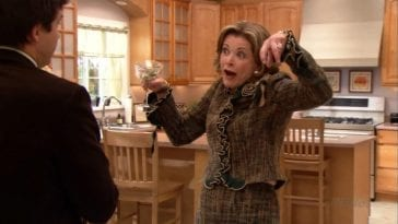 Lucille throws her hands up to mock her son