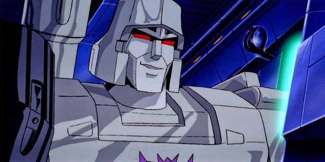 The Decepticon Megatron sneers while watching a computer screen.