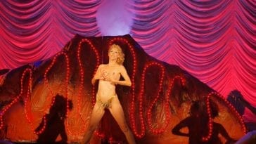 April Kidwell as Nomi Malone in the stage showgirls