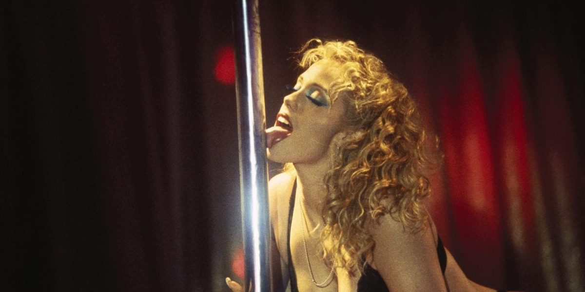 Nomi Malone licking a stripper pole