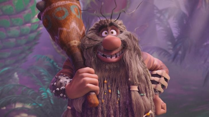 Captain Caveman holds his club with a smile.