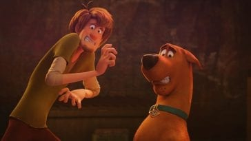 Shaggy and Scooby react in a frightened way to something in front of them